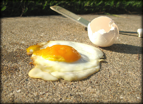 frying egg on the side walk